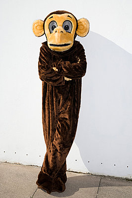Displeased person in monkey costume - p9247321f by Image Source