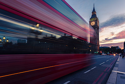 UK, London, red bus passing Westminster Bridge with Big Ben tower in the background at sunset - p300m1047539f by Michael Zwahlen