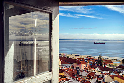 Portugal, Lisbon, view of Alfama neighborhood and River Tejo through open window - p300m999003f by klublu