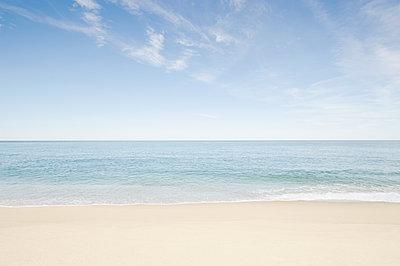 Sandy beach with ocean - p1427m2254877 by Chris Hackett