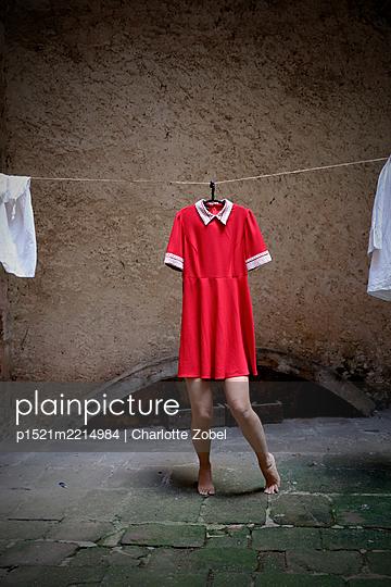 Red dress with women leg - p1521m2214984 by Charlotte Zobel