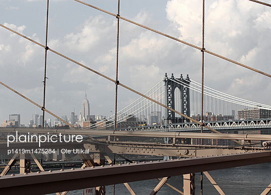 Empire State Building from Brooklyn Bridge - p1419m1475284 by Ole Utikal