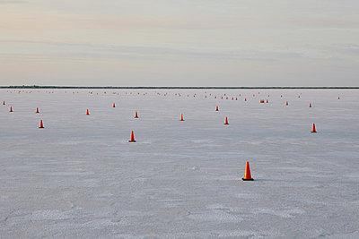 Traffic cones on race course, Bonneville Salt Flats, Speed Week, dusk - p1100m876432f by Paul Edmondson