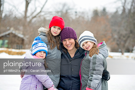 Mother and Daughters Outdoors in Winter - p1166m2141086 by Cavan Images