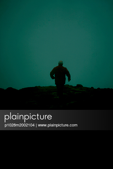 Old man running away - p1028m2002104 by Jean Marmeisse