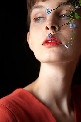 Woman's Face with Forget-me-not Sprigs - p1248m2108607 by miguel sobreira