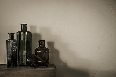 Collection of old glass bottles - p1228m1119493 by Benjamin Harte