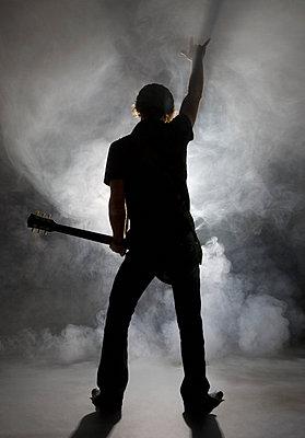 Man playing guitar - p4428185f by Design Pics