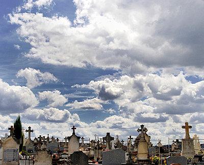 Cemetery beneath striking sky - p1072m829448 by Neville Mountford-Hoare