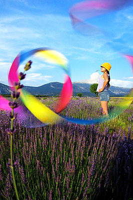 Girl in lavender field - p1468m1528676 by Philippe Leroux