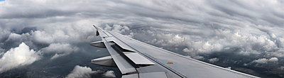 Airplane wing flying over clouds - p42917440f by bergh.dk