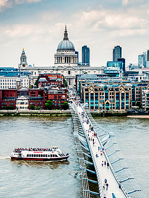 Tourists on Millennium Bridge with St. Paul's Cathedral in the background, viewed from Tate Switch; London, England - p442m2003743 by Charles Bowman