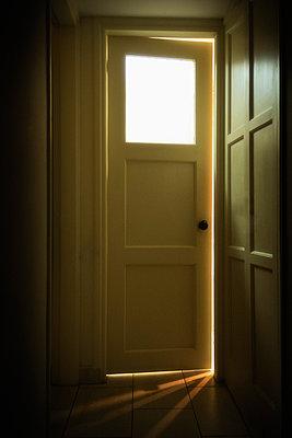 Light Shines Through The Door Slot   - p847m888114 by Bildhuset