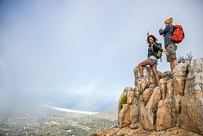 Young couple on mountain peak - p1355m1574152 by Tomasrodriguez