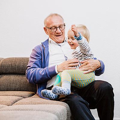 Fooling around with grandpa - p606m2178646 by Iris Friedrich