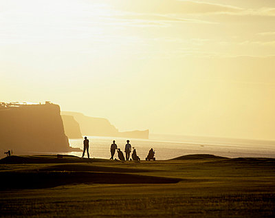 Ballycastle Golf Club, Co Antrim, Ireland; Silhouetted people playing golf - p4429802 by The Irish Image Collection