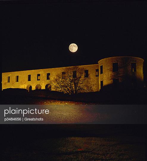 View of full moon shining against dark sky