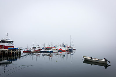 Boats in foggy harbor - p312m1211107 by Stefan Isaksson