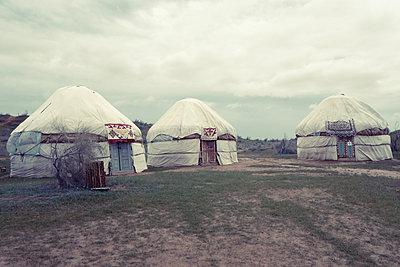 Three yurts in Aydar Lake, Uzbekistan - p1189m2176169 by Adnan Arnaout