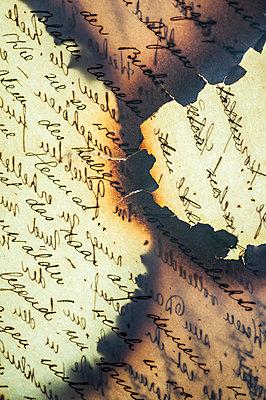 Burnt letters - p971m2064493 by Reilika Landen
