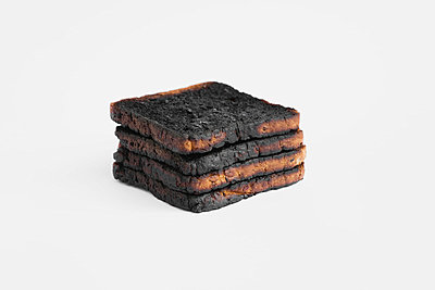 Burnt toast slices, stacked - p30016358f by Gaby Wojciech