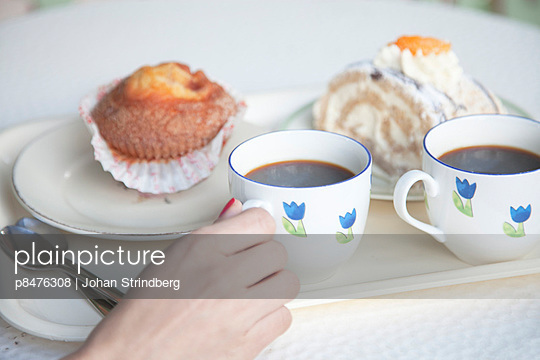 Two cups of coffee, cakes and buns with pastry