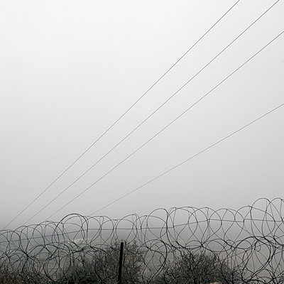 Hebron, barbed wire in the fog - p1542m2142388 by Roger Grasas