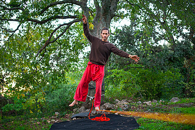 Man walking a slack line - p1007m1216540 by Tilby Vattard