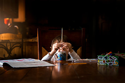 A Small Boy Painting A Watercolor Picture - p1166m2094748 by Cavan Images