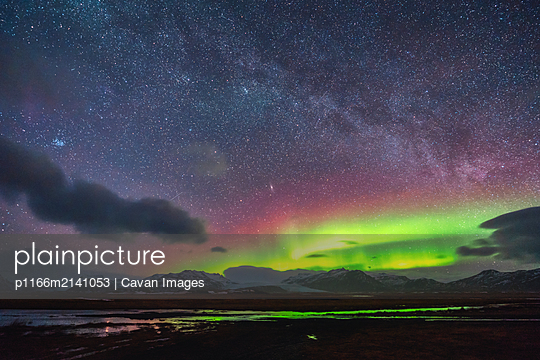 Northern lights dancing with part of the milky way - p1166m2141053 by Cavan Images