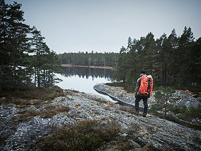 Hiker at water - p312m1229232 by Stefan Isaksson