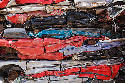 Stack of crushed cars - p9243812f by Image Source