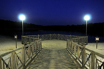 Jetty at night - p1072m829443 by Neville Mountford-Hoare