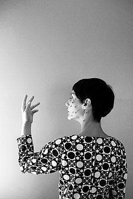 Dots on face - p1521m2116503 by Charlotte Zobel