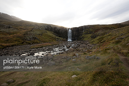 Waterfall and rocky stream in remote field - p555m1306171 by Kyle Monk