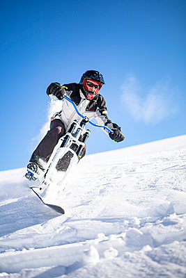 France, Man riding skibike - p1007m2216560 by Tilby Vattard