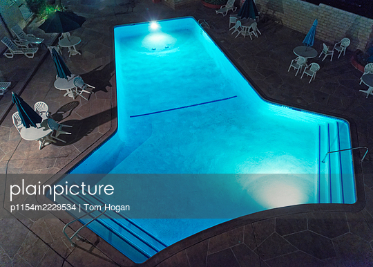 USA, California, Illuminated Swimming Pool at Night - p1154m2229534 by Tom Hogan