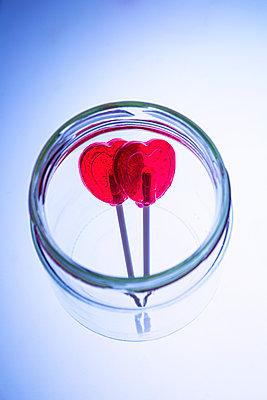 Two heartshaped lollipops in jar - p1149m2192775 by Yvonne Röder