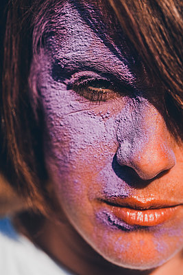 Woman with colour powder on face, Holi Festival - p1628m2211451 by Lorraine Fitch
