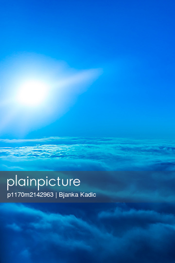 View of clouds and sky from an airplane - p1170m2142963 by Bjanka Kadic