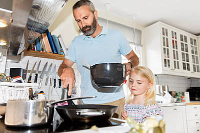 Girl cooking with father - p312m1192737 by Susanne Kronholm