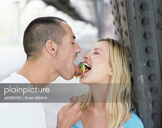 Young couple with lolly - p2260102 by Sven Görlich