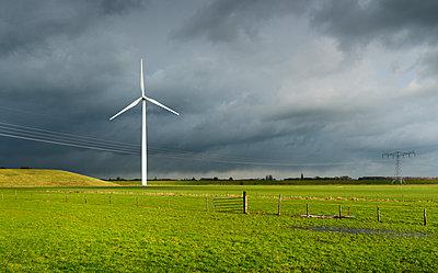 Wind turbine and solar panels on former waste dump, Waalwijk, Noord-brabant, Netherland - p429m1022604 by Mischa Keijser