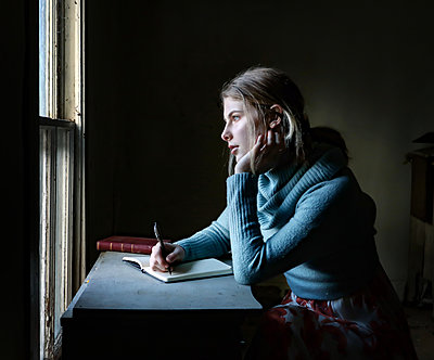 Girl writing a diary - p1019m2148274 by Stephen Carroll