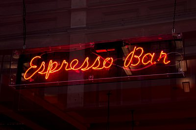 Neon sign at night - p429m1106675f by Seb Oliver