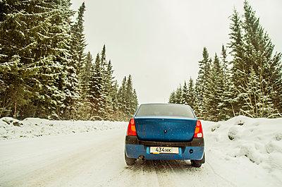 Car driving on snowy remote road - p555m1414464 by Aleksander Rubtsov