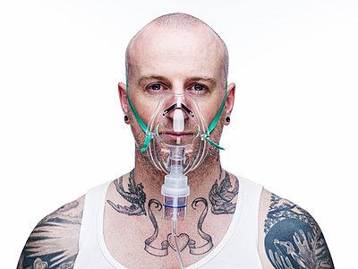 Man with tatoos - p5840572 by ballyscanlon