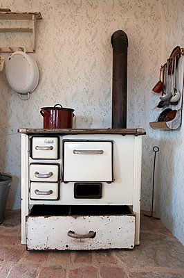 A wood-fired oven in the corner of a kitchen - p1183m996144 by Feig/Feig