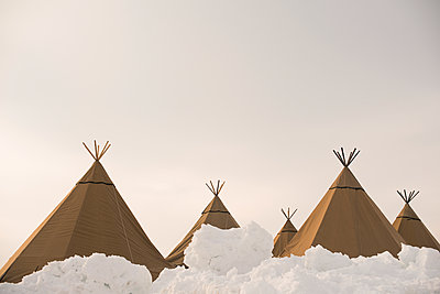 Teepees in snow - p312m1180458 by Juliana Wiklund