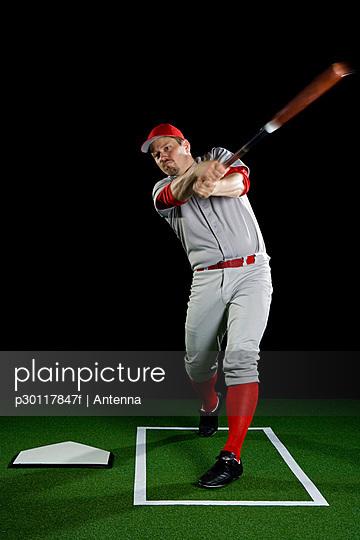 A baseball player swinging a bat